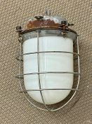 An Opaline Industrial lamp, with cage.