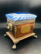 A Copper and Glass Lidded caddy on ball and claw feet with lion loop handles.