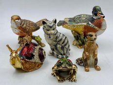 A selection of small decorative aminals with storage department