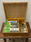 A box of Subbuteo teams, footballs and miniature trophy's