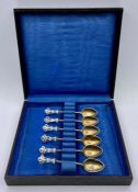 A boxed set of silver and enamel coffee spoons