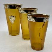 A set of three graduated silver rimmed beakers AF with a London hallmark.