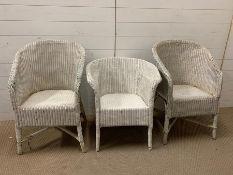 Three Lloyds Loom white chairs