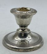 A Silver squat candlestick by James Deakin & Sons Chester 1913, 6 cm high.