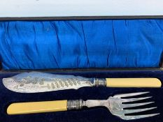 A Boxed set of fish servers with Sheffield hallmarked silver collars, makers mark CB