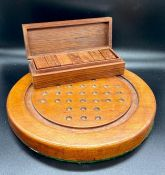 A Solitaire board and a wooden case domino set with brass detail and a Windsor edition monopoly as