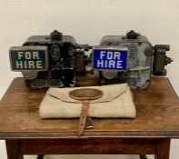 Two vintage Argo taxi cab meters along with a British Rail bag