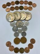 A small selection of coins including USA dollars and a half dollar