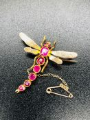 An interesting Dragonfly brooch in gold metal with stone body and safety chain 4.5cm L