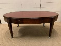 A mahogany coffee table of a oval shape with inlay and drawers to sides (H45cm W107cm D56cm)