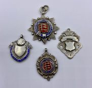 A Selection of four silver football medals