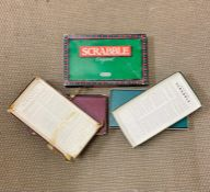 """Three versions of the board game """"Scrabble"""" of various ages"""