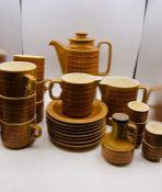 """A 1970's Hornsea Pottery """"Saffron"""" tea service to include, six cups and eight saucers, tea pot, milk"""