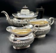 A Three piece silver tea set to include teapot, milk jug, sugar bowl (Arthur & John Zimmerman) Total
