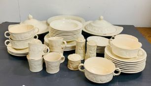 A part set of Royal Worcester Crown Ware dinner service with a fruit decoration around the edge of