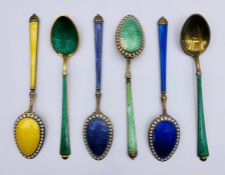 A selection of seven various enamel on silver spoons