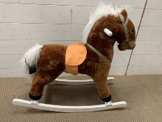 A children's plush rocking horse (H70cm W76cm)