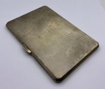A Birmingham hallmarked cigarette case, machine tooled, dated 1939 makers mark K&D, Kendal and Dent.