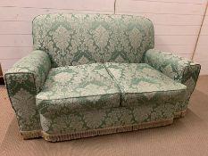 A two seater sofa (H80cm W150cm D74cm)