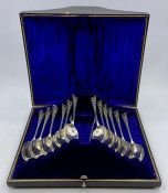 A cased set of twelve silver teaspoons and sugar nips by GGR, hallmarked for Sheffield 1898