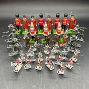A selection of lead soldiers including Britains