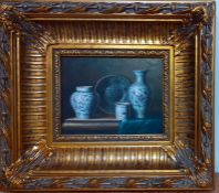 A 20th century Middle East school, 'Still life with western asian blue and whithe vases', oil on