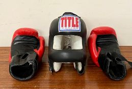 A pair of boxing gloves and head shield