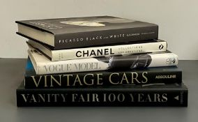 A collection of five large reference books including those on Vogue Model and Chanel