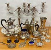 A large volume of silver plated items including a pair of substantial three light candlesticks