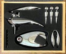 A boxed cork screw/bottle opening set
