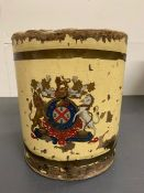 A vintage paper Mache bucket with a crest to front