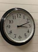 A large kitchen clock