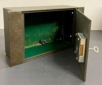 A metal wall cash safe