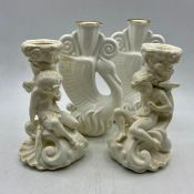 A pair of Royal Doulton Ambassador swan candle sticks and a pair of candlestick in the form of a