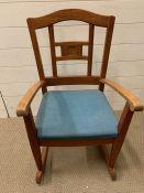 A teak child's rocking chair
