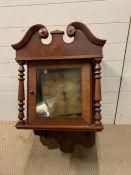 A mahogany cased hooded wall clock