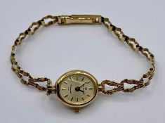 A Ladies Sovereign 9ct gold watch and strap (Total weight 8.8g)