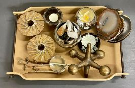 A selection of decorative objects on a suede effect tray