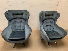 A pair of petrol blue egg chairs