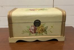 A small painted wooden trunk decorated with flowers (H25cm W45cm D29cm)