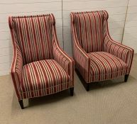A pair of red striped upholstered library style chairs
