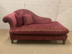 A small chaise longue with scrolled end and pink wave upholstery (H90cm W170cm D87cm)