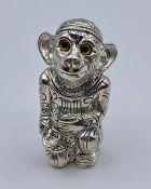 A Silver plated monkey pin cushion