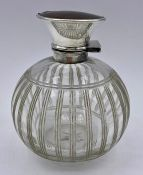 A Hallmarked silver and tortoiseshell topped scent bottle