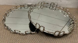 A pair of mirrored chrome trays with a horse bit design to edge (Dia45cm)