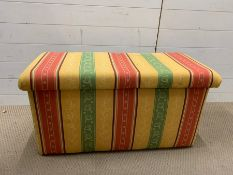 An upholstered blanket box with original handles