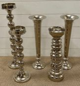 Three chrome candle holders and two trumpet vase (Tallest H60cm)