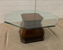 A glass top hexagon side/coffee table on an interesting mahogany base (42cm x 91cm)