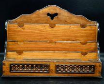 A carved letter rack
