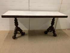 A marble top console table on ornate carved legs depicting animals (H83cm W185cm D59cm)